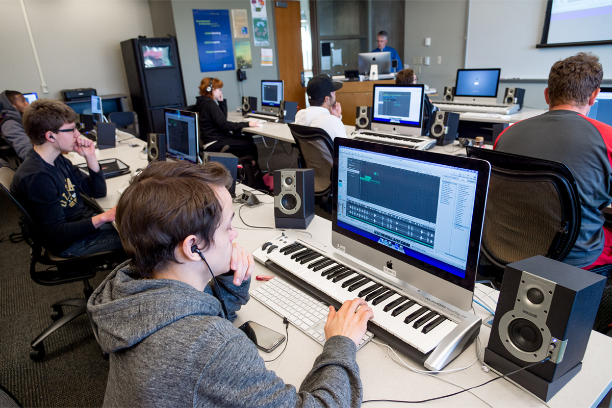 A Digital music class with students using keyboards and computers