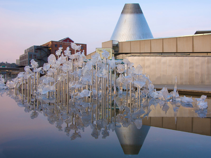 The Museum of Glass cone reflected in the sculpture pond